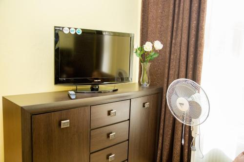 A television and/or entertainment center at Krakow style apartment