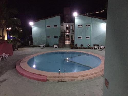 The swimming pool at or near Condomínio Taperapuã Praia Village