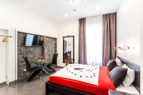 Una habitación en Komorowski Luxury Guest Rooms