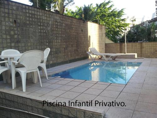 The swimming pool at or near Apartamento Guarujá Enseada