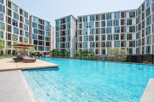 The swimming pool at or near The Base Uptown By Favstay