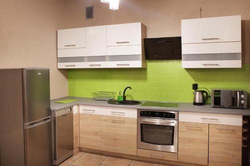 Virtuvė arba virtuvėlė apgyvendinimo įstaigoje Apartament Milena