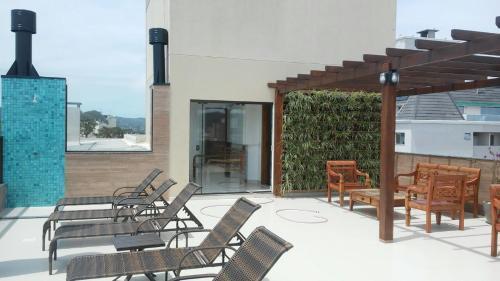 Uma varanda ou outra área externa em Fragata Apart Hotel