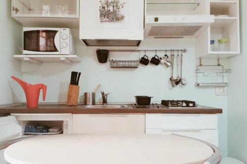 A kitchen or kitchenette at Flat White Pompei