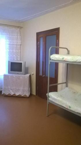 A bunk bed or bunk beds in a room at Hostel Uyutny