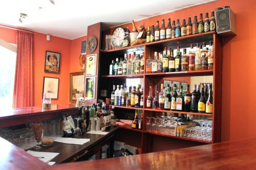 De lounge of bar bij Hotel Medio Apartments