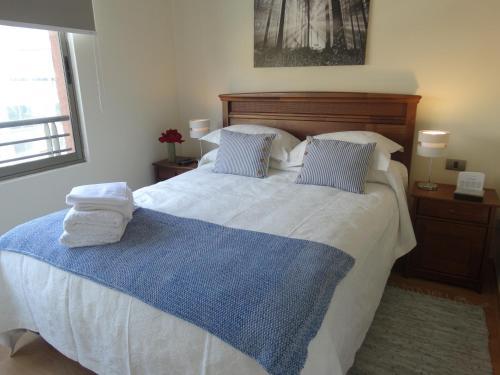 Cama o camas de una habitación en Departamento Parque de los Reyes