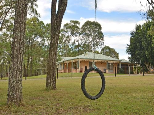 A garden outside Merewether Homestead with Pool and Family friendly