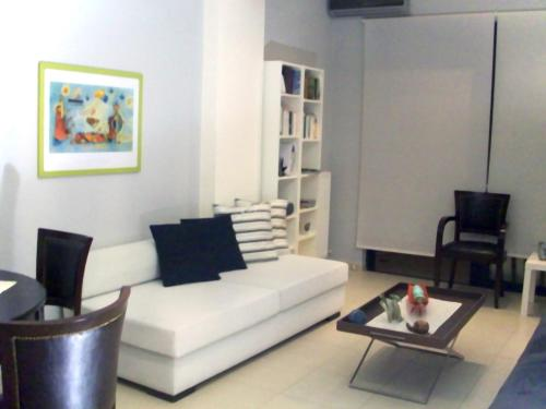 A seating area at Posto City Center Apartment