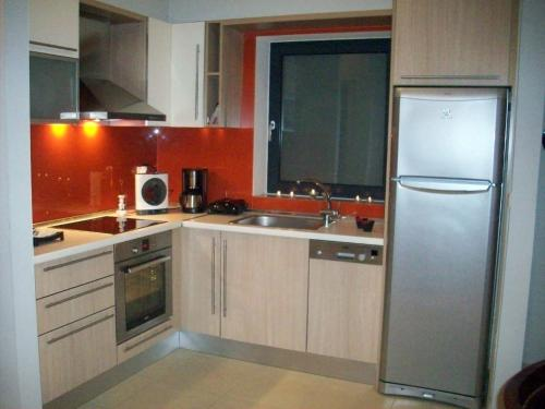 A kitchen or kitchenette at Posto City Center Apartment