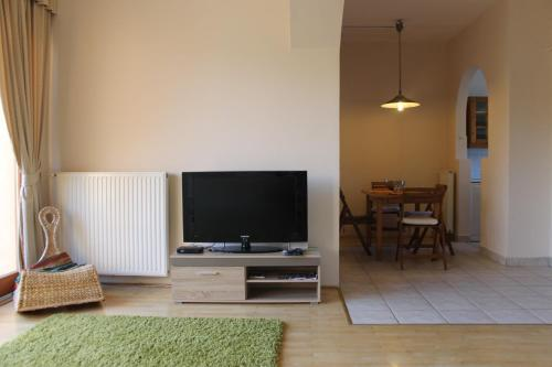 A television and/or entertainment center at Angelland with Garden