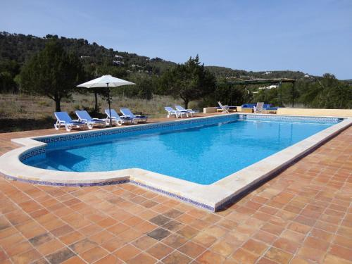 The swimming pool at or near Modern Holiday Home in Es Cubells with Private Pool