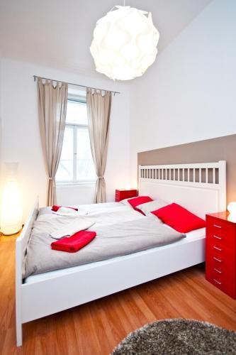 מיטה או מיטות בחדר ב-Budget Apartment