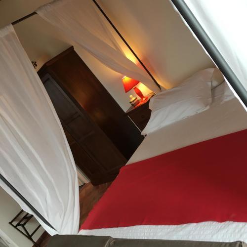 Letto o letti in una camera di Castello di Monteriggioni