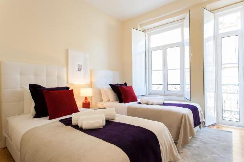 Uma cama ou camas num quarto em Graca Deluxe Apartments   RentExperience