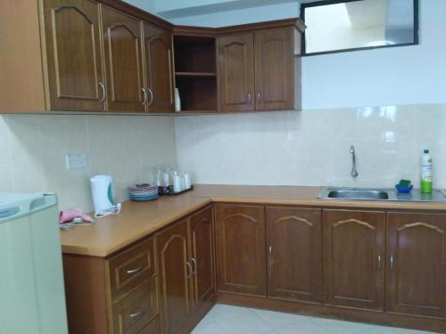 A kitchen or kitchenette at Lumut Apartment