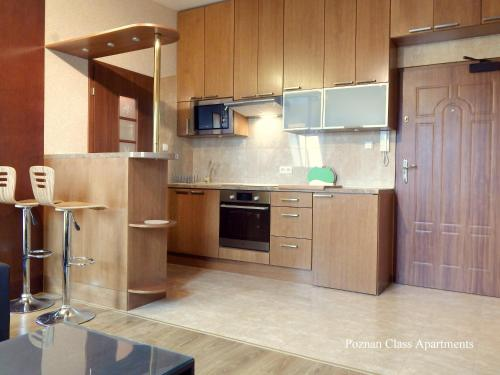 Poznań Class Apartments tesisinde mutfak veya mini mutfak