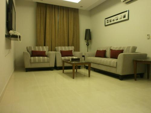 A seating area at Drr Ramah Suites 4