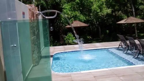 The swimming pool at or near Apartamento Condomonio Antares