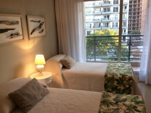 Una cama o camas en una habitación de Estudio Boutique Barrio Norte
