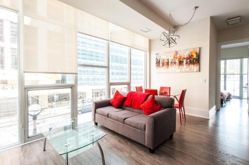Zona de estar de Veeds Private Suites - Front Street West Toronto