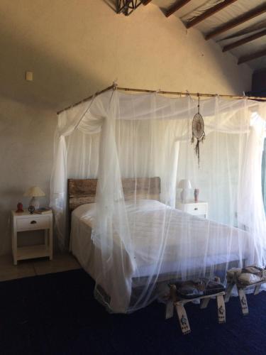Een bed of bedden in een kamer bij Studio Casa Yogashal