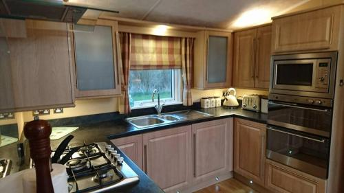 A kitchen or kitchenette at St. James 28 at Marton Mere