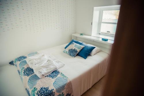 Uma cama ou camas num quarto em Vigia da Areia