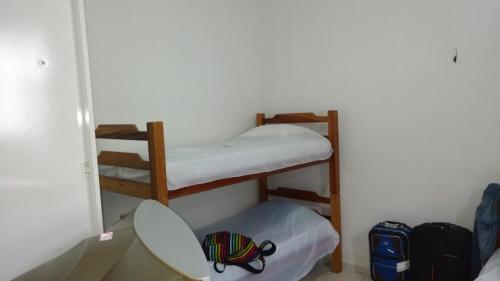 A bunk bed or bunk beds in a room at Residencial Dom Luiz