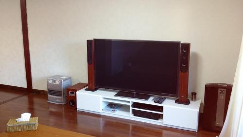 A television and/or entertainment center at lan's home