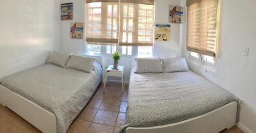 A bed or beds in a room at The Coral Keys