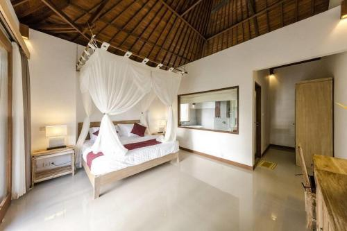 Un ou plusieurs lits dans un hébergement de l'établissement Villa Sekaya Ubud