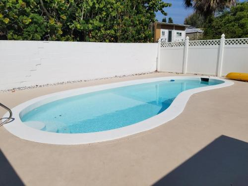 The swimming pool at or near Cute Bungalow near the Beach and River with Private Pool