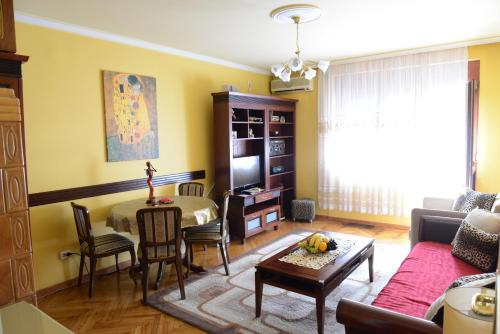 Гостиная зона в Apartment Modus