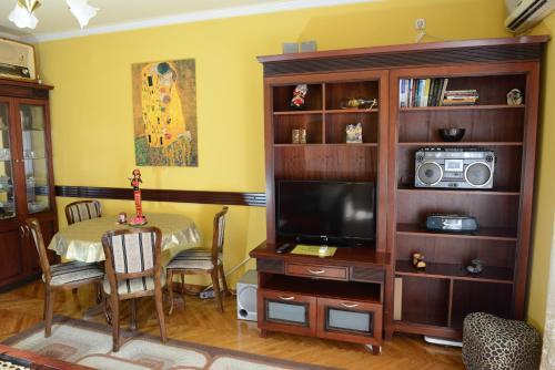 Телевизор и/или развлекательный центр в Apartment Modus