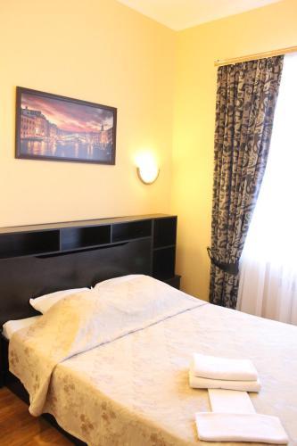 Кровать или кровати в номере Гостиница Уют