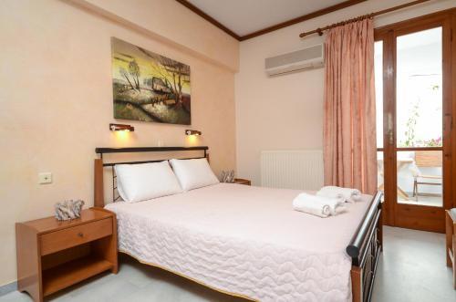Ένα ή περισσότερα κρεβάτια σε δωμάτιο στο Rena Valetta Studios