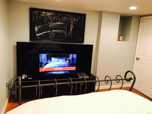 A television and/or entertainment center at Studio H St Corridor