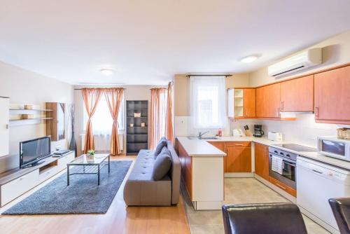 A kitchen or kitchenette at Nova Aparthotel