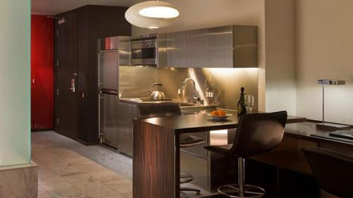 A kitchen or kitchenette at Studio with Strip View & Balcony
