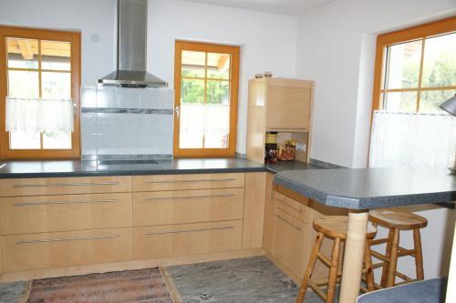 A kitchen or kitchenette at Ferienwohnung Bacher