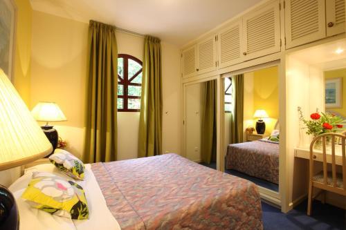 Cama o camas de una habitación en Canico Bay Apartments