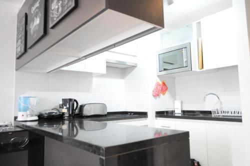 Una cocina o zona de cocina en Kennedy Apartments Los Militares