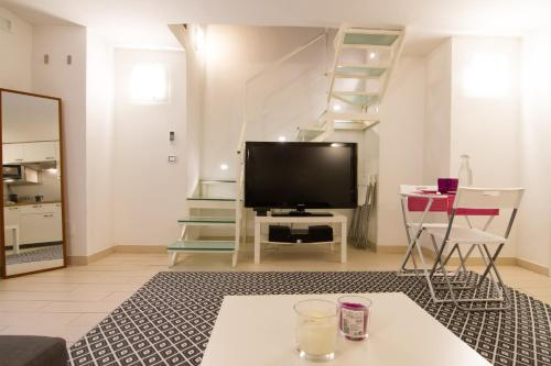 Telewizja i/lub zestaw kina domowego w obiekcie Relax Partenopeo