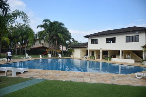 The swimming pool at or near Casa Maravilhosa