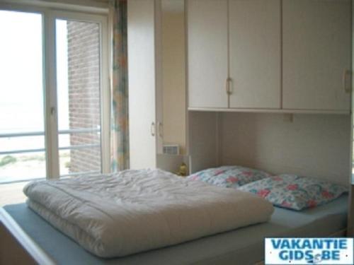 Een bed of bedden in een kamer bij Residence Scorpio