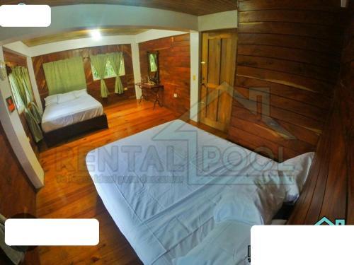 Cama o camas de una habitación en Villa Ribera Del Yaque