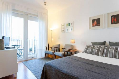 A bed or beds in a room at Santa Catarina Apartamento