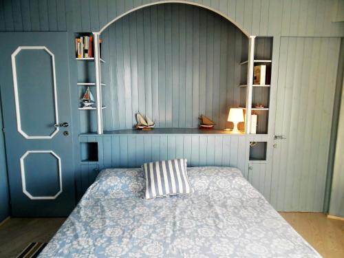 Łóżko lub łóżka w pokoju w obiekcie House in Punta Chiappa