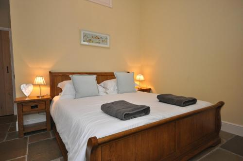 A bed or beds in a room at Molesworth Barn